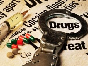 drugs-with-handcuffs-5-17-12