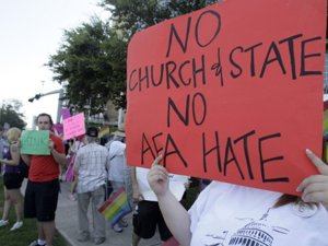 opponents-of-the-response-protest-the-american-family-association-the-conservative-organization-that-paid-for-the-rally
